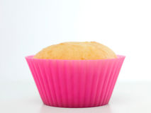 Single plain cupcake in pink silicone mould Royalty Free Stock Photos