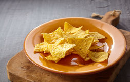 Single plate of tasty yellow tortilla chips Stock Image