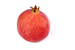 Single pomegranate. Single ripe whole pomegranate on white background Royalty Free Stock Images