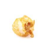 Single popcorn flake isolated. Single cheese flavored orange popcorn flake isolated over the white background Stock Image