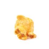Single popcorn flake isolated. Single cheese flavored orange popcorn flake isolated over the white background Royalty Free Stock Photos
