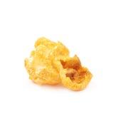 Single popcorn flake isolated. Single cheese flavored orange popcorn flake isolated over the white background Stock Photos