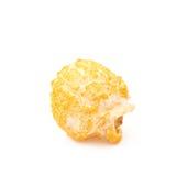 Single popcorn flake isolated. Single cheese flavored orange popcorn flake isolated over the white background Stock Images