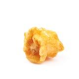 Single popcorn flake isolated. Single cheese flavored orange popcorn flake isolated over the white background Stock Photo