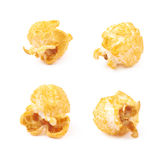 Single popcorn flake isolated. Single cheese flavored orange popcorn flake isolated over the white background, set of four different foreshortenings Royalty Free Stock Photo