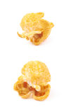 Single popcorn flake isolated. Single cheese flavored orange popcorn flake isolated over the white background, set of two different foreshortenings Royalty Free Stock Images
