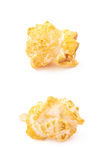 Single popcorn flake isolated. Single cheese flavored orange popcorn flake isolated over the white background, set of two different foreshortenings Royalty Free Stock Photography
