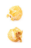 Single popcorn flake isolated. Single cheese flavored orange popcorn flake isolated over the white background, set of two different foreshortenings Stock Images