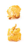 Single popcorn flake isolated. Single cheese flavored orange popcorn flake isolated over the white background, set of two different foreshortenings Royalty Free Stock Photos