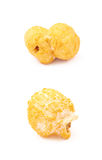 Single popcorn flake isolated. Single cheese flavored orange popcorn flake isolated over the white background, set of two different foreshortenings Royalty Free Stock Photo