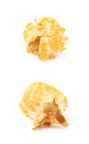 Single popcorn flake isolated. Single cheese flavored orange popcorn flake isolated over the white background, set of two different foreshortenings Stock Image