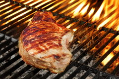 Single Pork Loin Steak On Hot With Fork Royalty Free Stock Images