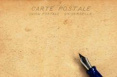 Single Postcard. Antique postcard with a fountain pen Stock Photography