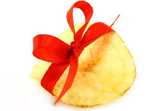 Single potato chip with red bow Stock Photo