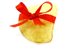Single potato chip with red bow Royalty Free Stock Image