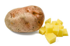Single potatoe with some diced. One isolated on white Royalty Free Stock Image