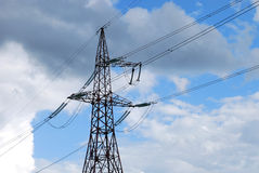 Single power line tower. On the cloudy sky background Royalty Free Stock Photos