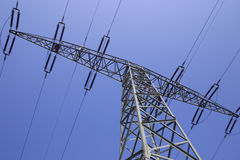 Single Power Pole. A single power pole against the blue sky Stock Image