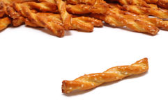 Single Pretzel. With Many Pretzels in the Background Royalty Free Stock Image