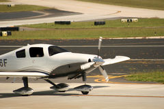 Single Prop Plane. Landing on runway Royalty Free Stock Photos