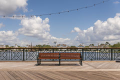 Single public bench on a boardwalk Royalty Free Stock Photography