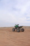 Single quad bike in the desert Royalty Free Stock Image