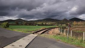 Single railway track. In Rana, Central Bohemian Highlands, Czech Republic stock footage