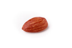 Single raw almond. Single isolated raw almond on white background Royalty Free Stock Photography