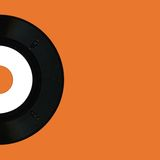 Single record. Half of single record or lp with orange background Royalty Free Stock Image