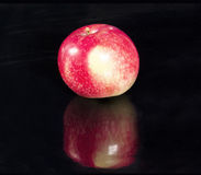 Single red apple. Isolated on a black background stock photography