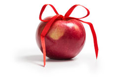 Single red apple with ribbon bow. On white stock photos