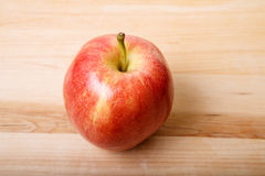 Single Red Apple on a Wood Cutting Board Royalty Free Stock Photo