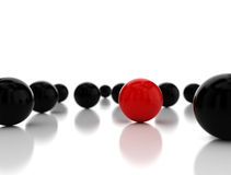 Single red ball standing out Royalty Free Stock Images