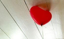 Single Red Balloon Trying To Escape Royalty Free Stock Photography