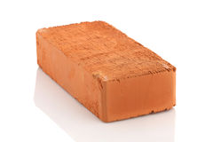 Single red brick  on white background Royalty Free Stock Photos