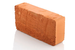Single red brick  on white background Royalty Free Stock Image