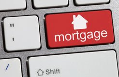 Single red button showing the word mortgage Stock Photography