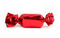 Single red candy isolated