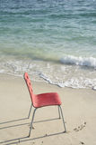Single Red Chair at Beach Stock Photos