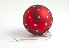 Single red christmas ball. With silver dots on a white background Royalty Free Stock Photography