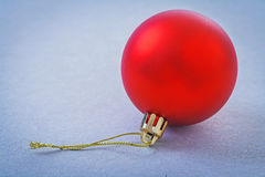 Single red christmas ball on gray background Stock Photos