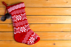 Single red color empty woollen Christmas stocking Royalty Free Stock Photo