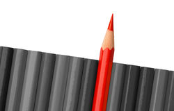 Single red crayon is sticking out of the gray row Stock Photography