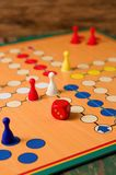 Single red dice on Ludo board Stock Images