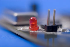 Single red diode on electronic circuit  board Stock Photo