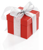 Single red gift box with gold ribbon on white back Stock Photos
