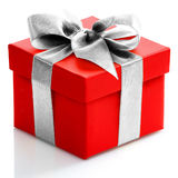 Single red gift box with gold ribbon on white background. Royalty Free Stock Photography