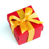 Single red gift box with golden ribbon Stock Photography