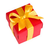 Single red gift box with golden ribbon Royalty Free Stock Images
