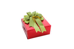 Single red gift box with green ribbon isolated on white backgrou Stock Photography